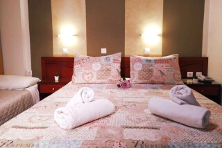 triple room semiramis hotel double bedroom